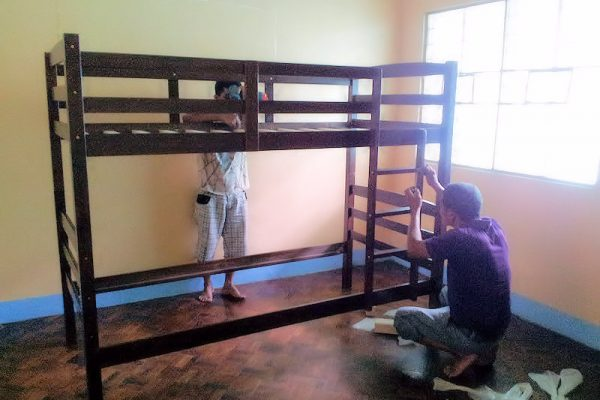 man-working-on-new-bed